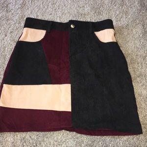 Creme, maroon, and black skirt